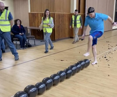 Idaho man breaks Guinness record for popping balloons with feet