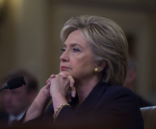 Clinton calls on Benghazi committee to avoid partisanship
