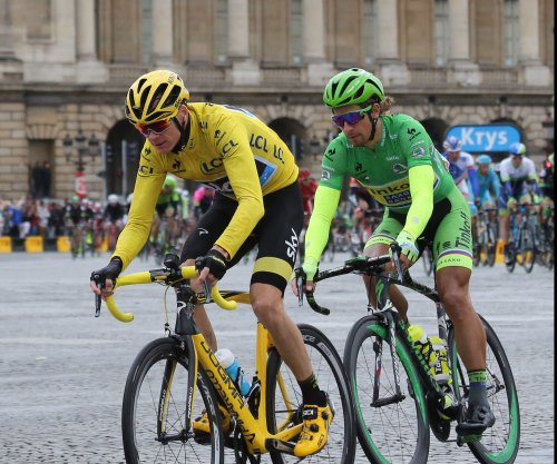 Tour de France: Chris Froome extends lead as Peter Sagan wins stage
