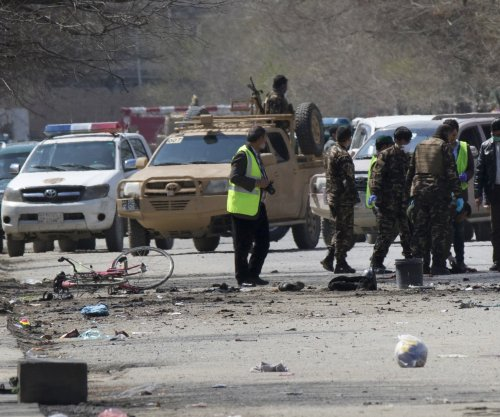 Car bomb in Afghanistan kills at least 12, injures dozens