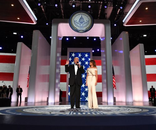 First lady Melania Trump wears white Hervé Pierre gown to inaugural balls