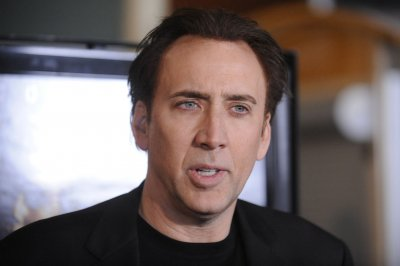 Stuntman does jumping jacks on fire at Nicolas Cage festival