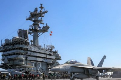 U.S. carrier strike group harassed by Iranian vessels as it leaves Middle East