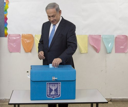 Benjamin Netanyahu declares 'great victory;' exit polls tied