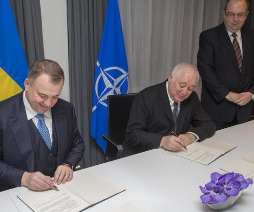 NATO, Ukraine officials sign defense cooperation agreement