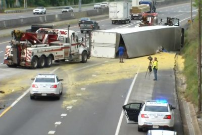 Overturned tractor trailer covers highway in mac and cheese