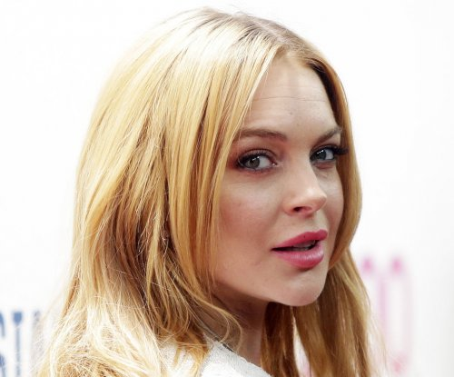 Lindsay Lohan contracts rare virus in French Polynesia