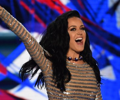 Katy Perry votes, attends Kanye West show on 32nd birthday