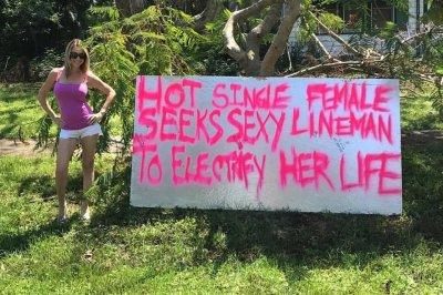 Florida woman's sign seeking 'sexy lineman' helps power get restored