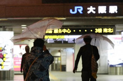 Tokyo halts train service as Typhoon Trami moves across Japan