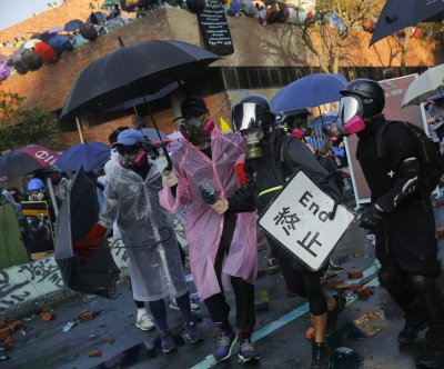 Arrow injures police officer during protest at Hong Kong university
