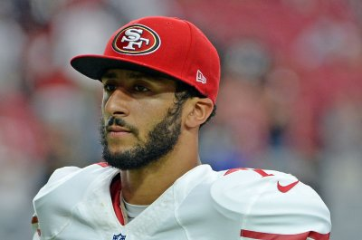 49ers QB Colin Kaepernick sits in protest during national anthem