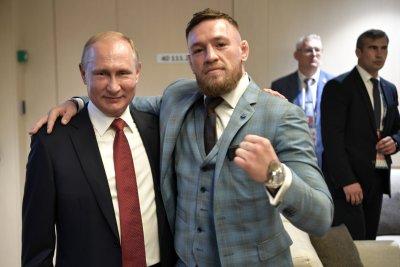 Conor McGregor watches World Cup alongside Vladimir Putin
