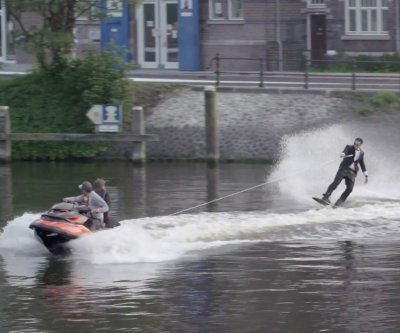 YouTube star wakeboards through Amsterdam canals while wearing a tuxedo
