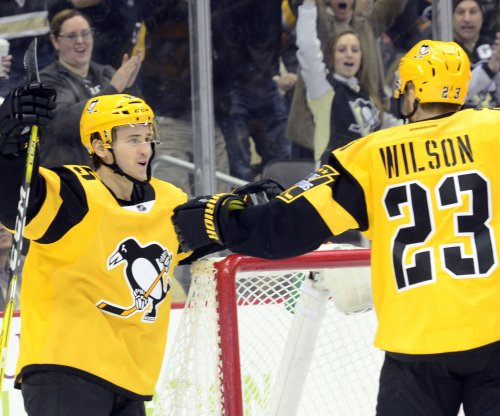 NHL: Pittsburgh Penguins sign forward Josh Archibald, defenseman Derrick Pouliot