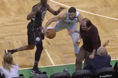 Fan manages to hold beer steady despite collision with Celtics' Tatum