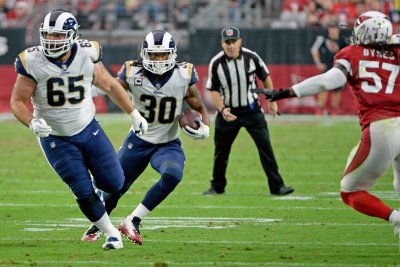 Rams don't pick up option on veteran C John Sullivan