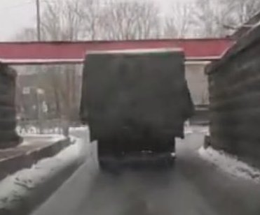 Tall semi truck trailer strikes low bridges