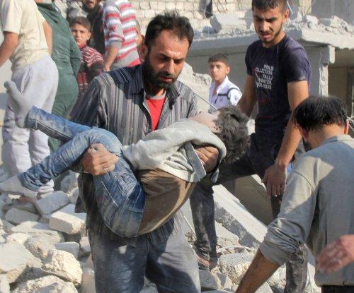 U.N. envoy says Syria peace talks will start Friday; U.S. denies threat to pull rebel support