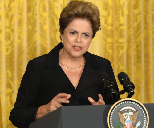 Brazil's largest ruling party votes to abandon seats in President Rousseff's cabinet over scandal