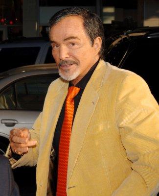 Actor Burt Reynolds hospitalized with flu