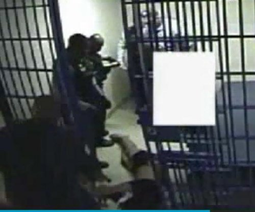 Video shows Chicago police repeatedly use Taser on man, drag him from cell