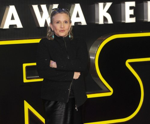 Carrie Fisher remains in intensive care after mid-flight heart attack