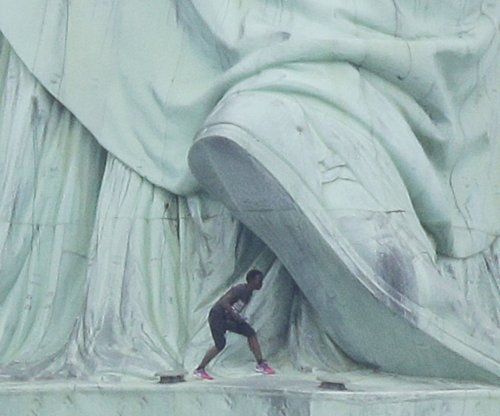 Woman climbs Statue of Liberty to protest Trump immigration policies