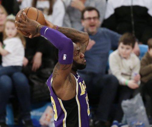 Kobe Bryant watches LeBron James' Lakers beat Hawks