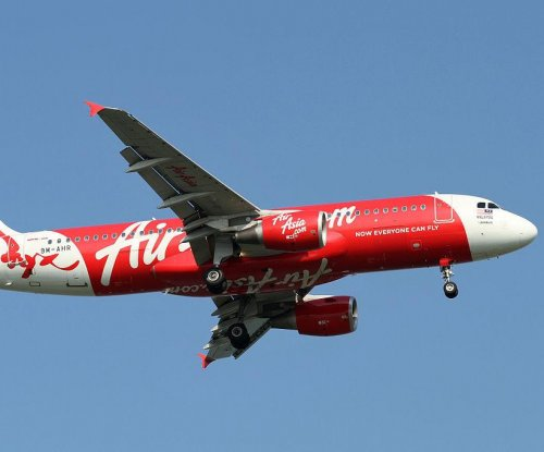 AirAsia: Divers reach fuselage, retrieve more bodies