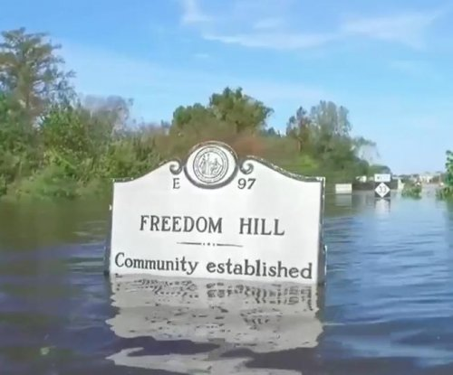 Two more dead as North Carolina governor visits flooded towns