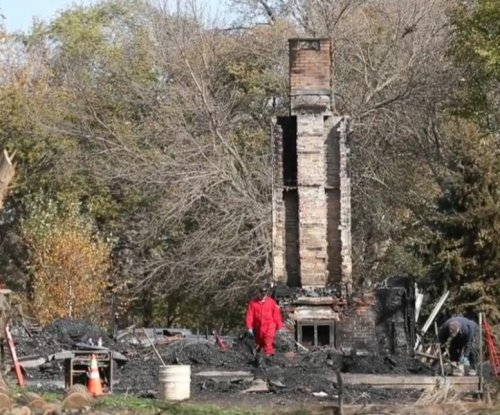 Fireplace embers blamed for house fire that killed family of six