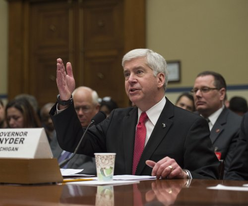 Michigan governor unveils plan for recovery in Flint water crisis