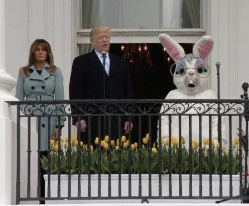 Trump touts economy, military at Easter Egg Roll