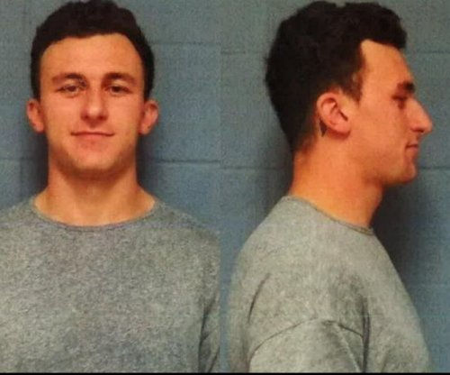Johnny Manziel booked on domestic-violence charge