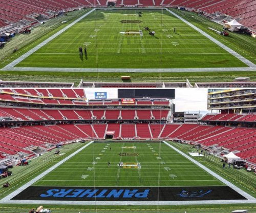 Super Bowl 50: Grounds crew paints Denver Broncos in both end zones