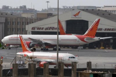 Air India 737 makes emergency landing after hitting wall on takeoff
