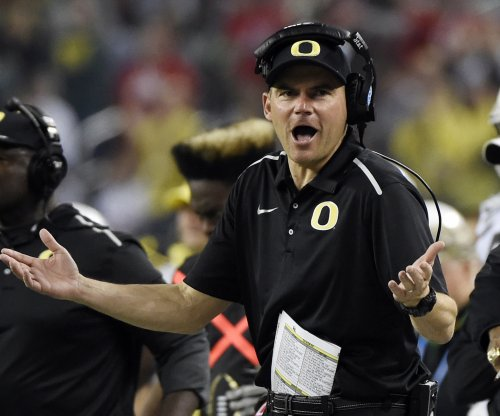 Oregon gives Helfrich 5-year extension