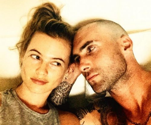 Adam Levine shows off bald head next to Behati Prinsloo