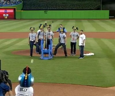 Florida students use catapult to launch first pitch at baseball game