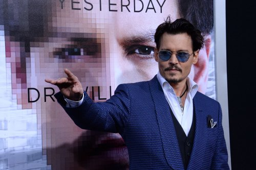Johnny Depp served with legal papers at Hollywood premiere