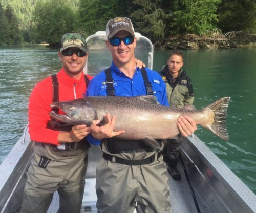 Peyton Manning goes fishing for salmon with Dierks Bentley