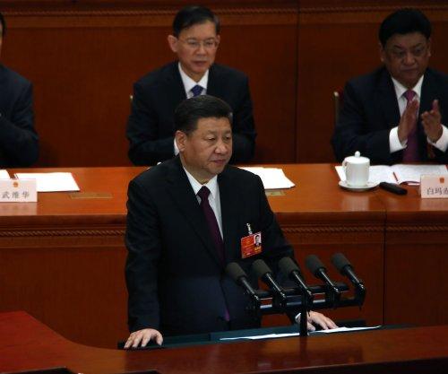 China to reduce auto tariffs after Trump criticism