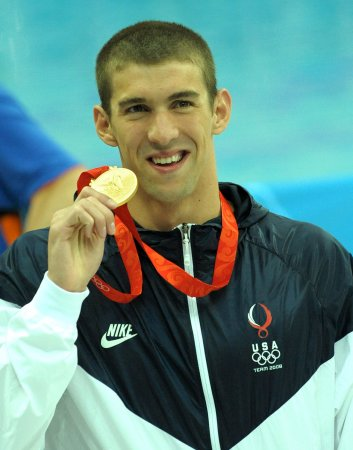 Phelps clears first Olympic hurdle