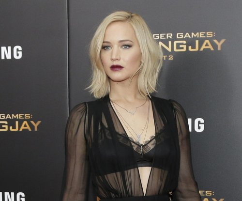 Every look Jennifer Lawrence wore to the 'Hunger Games' premieres