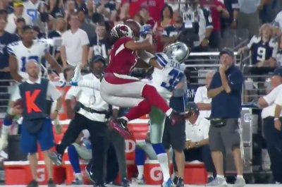 Arizona Cardinals' Larry Fitzgerald steals interception, makes crazy catch