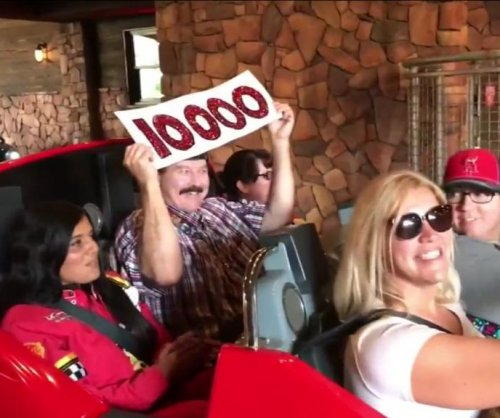 Man takes 10,000th spin on Disney's 'Cars' ride in California