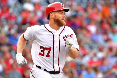 Nationals pitcher Stephen Strasburg hits 3-run bomb to top Braves