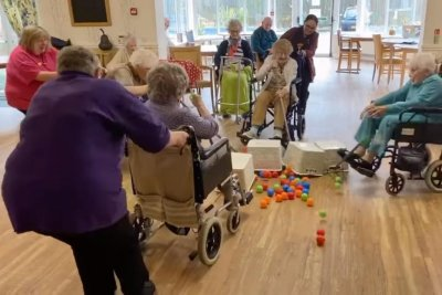 Nursing home residents play life-sized Hungry Hungry Hippos