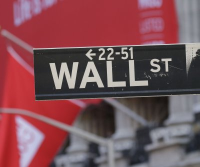 Dow sinks almost 900 points amid surging COVID-19 cases